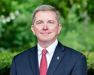 Headshot of Will Aiken